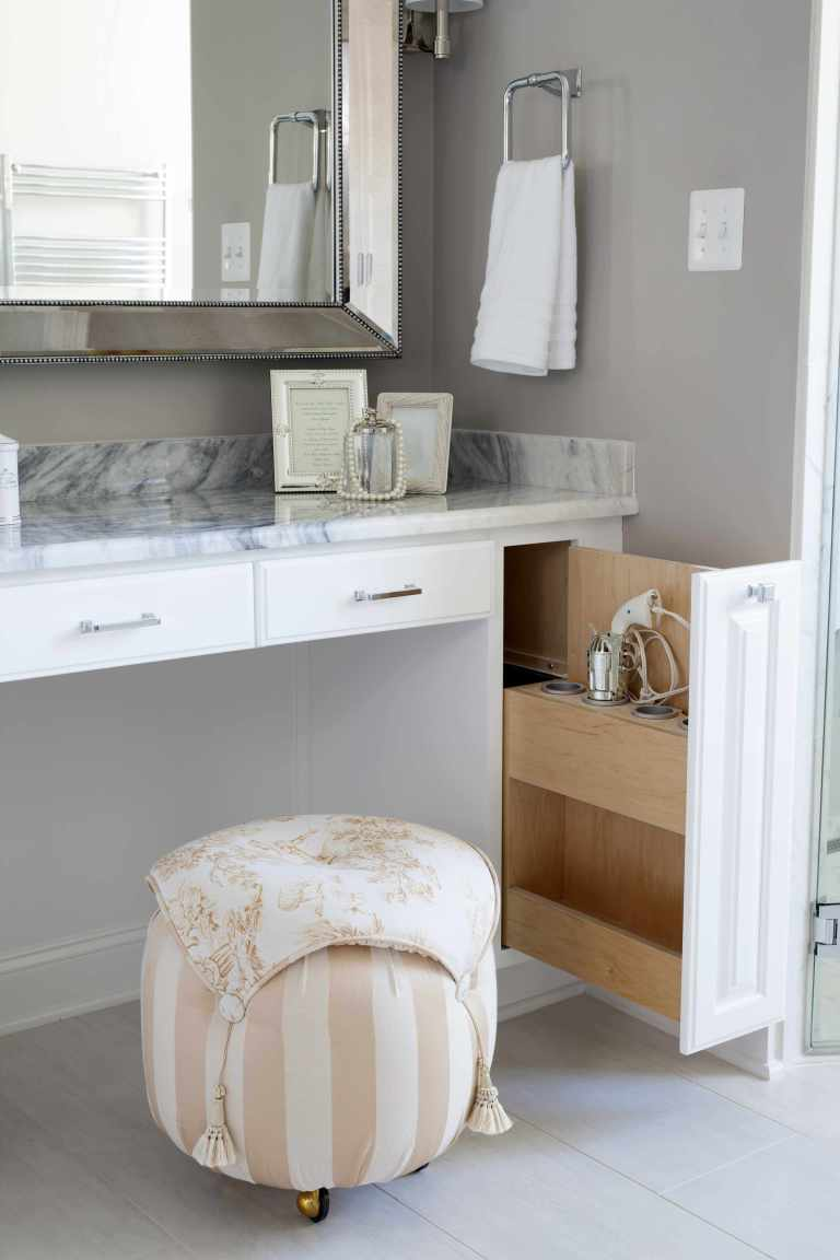 creative storage solutions at make up vanity in renovated bathroom