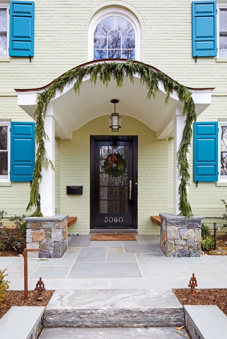 front entryway covered porch flagstone floors arched window outdoor lighting
