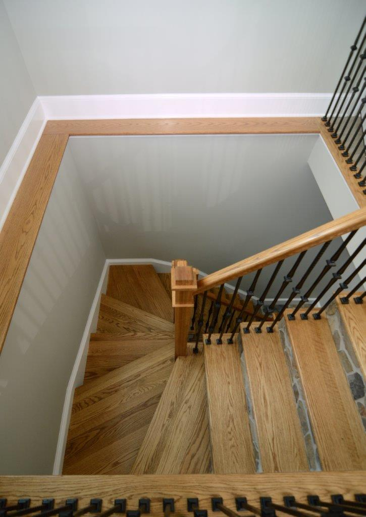 birds eye view of staircase with light wood banister