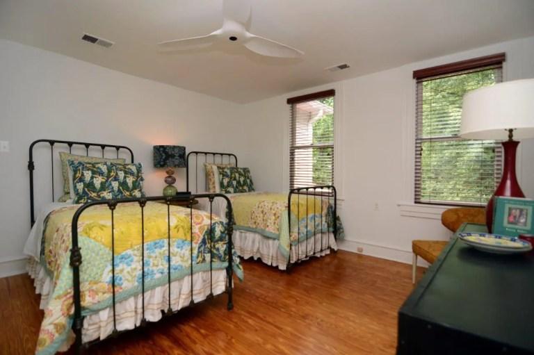 bedroom renovation white walls wood floors