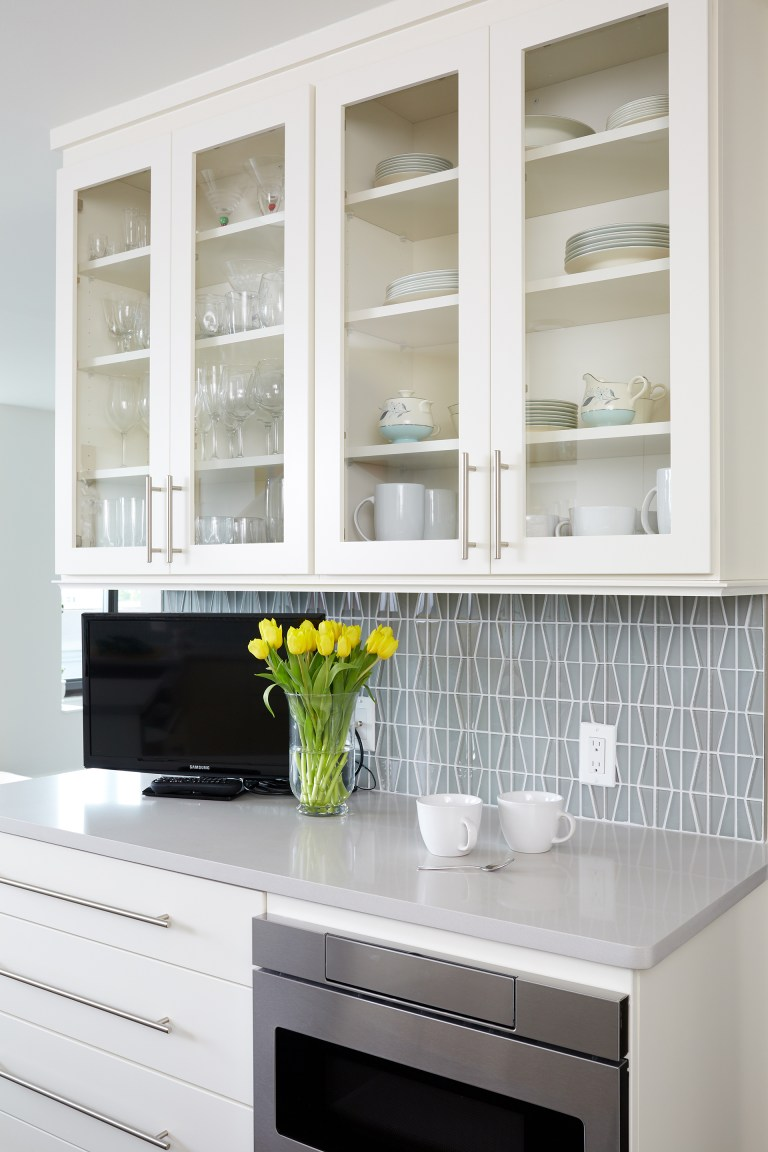 white cabinetry with glass door uppers
