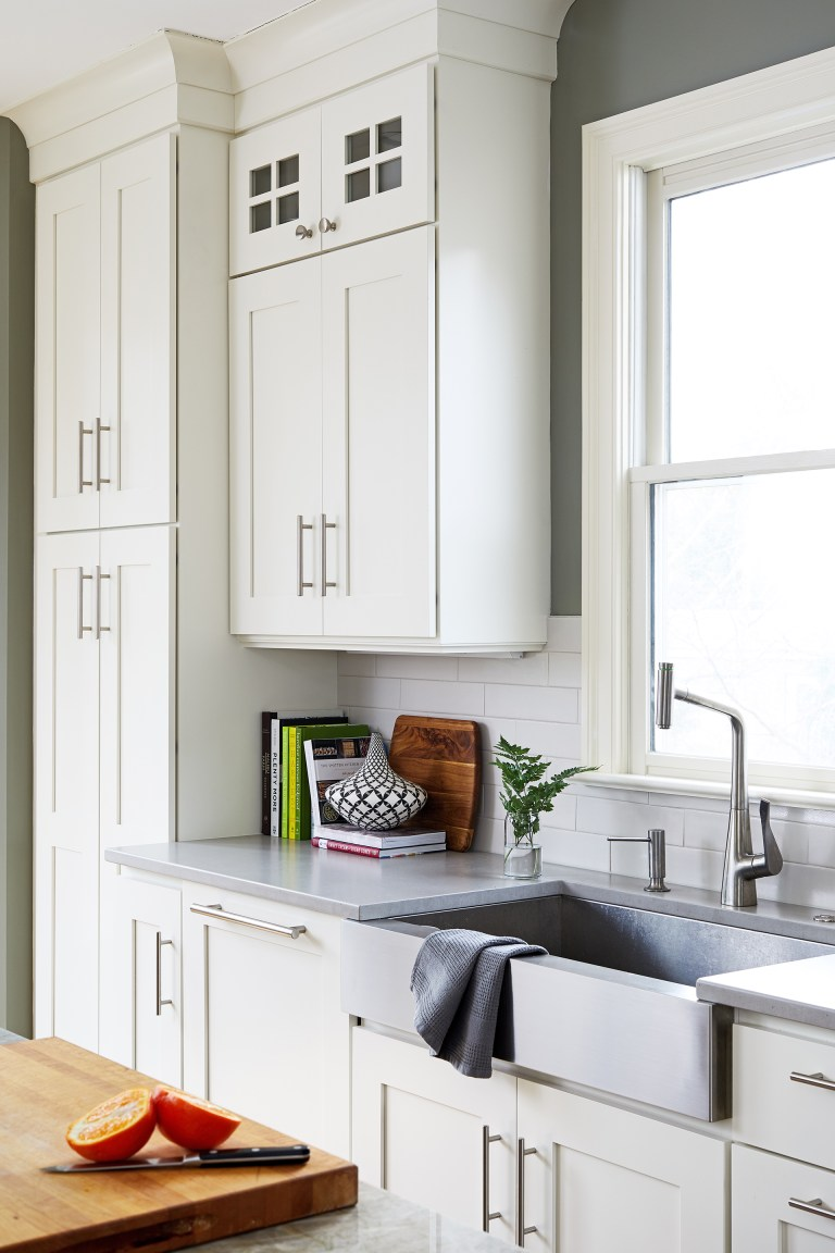 stainless steel apron sink in front of window