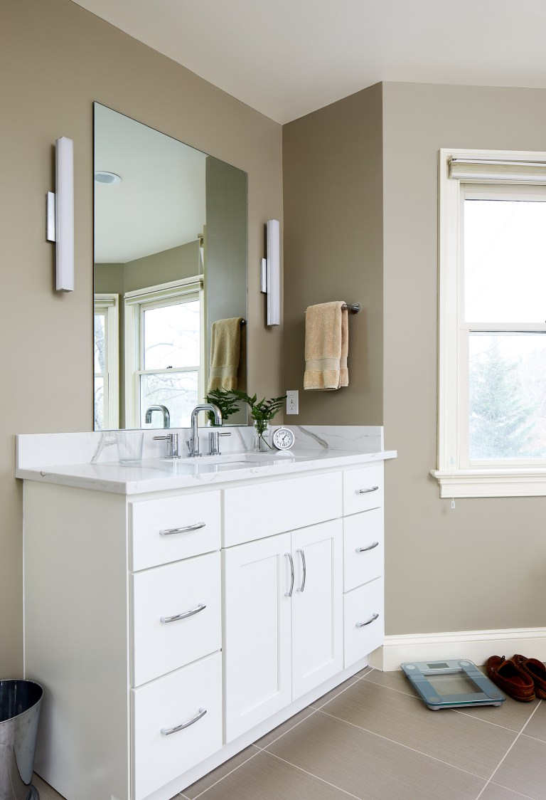 second vanity in master bathroom white cabinetry sconce lighting