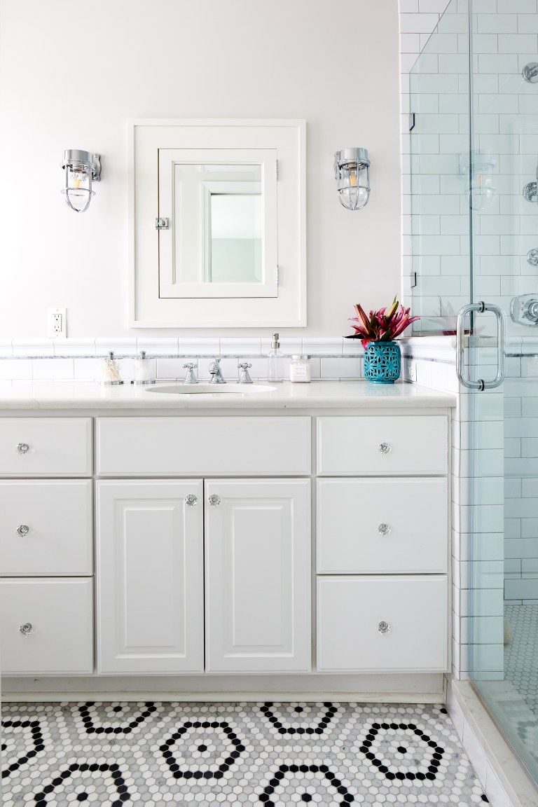 white bathroom with black and white geometric tile floors