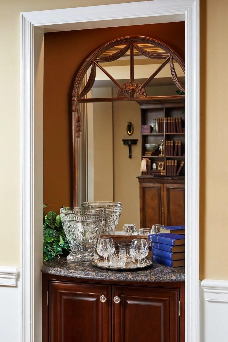 small 2 door wood corner cabinet with mirror