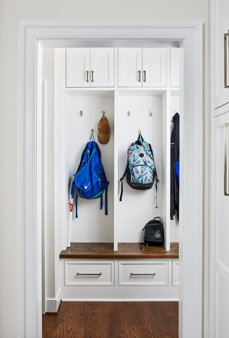 transitional open mudroom paneled walls with individual cubbies and drawers at the top and bottom