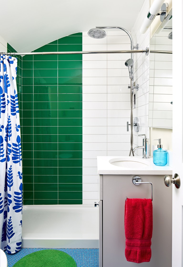 bathroom with walk in shower with large rain shower head