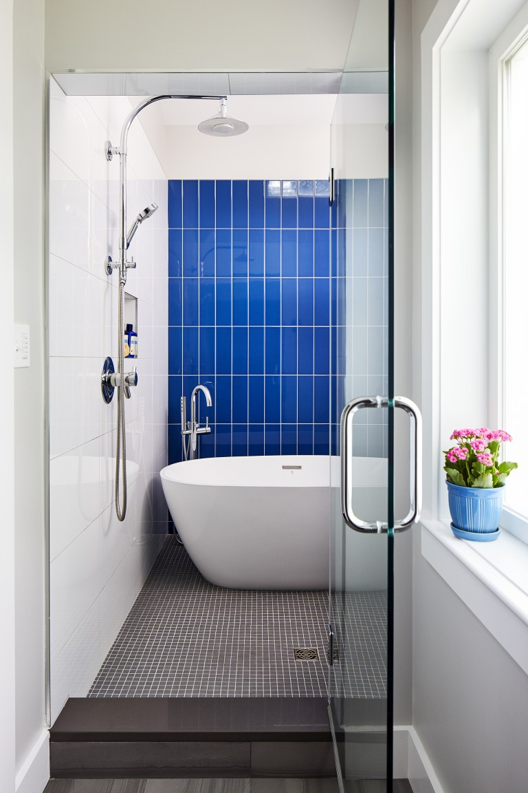large bathroom with tub inside a spacious shower