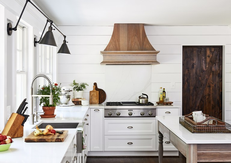 modern light shade of white cabinets with black sconces two lamps wall light fixtures with oak paneling custom range hood