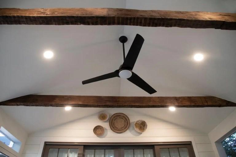 rustic ceilings beams with black ceiling fan