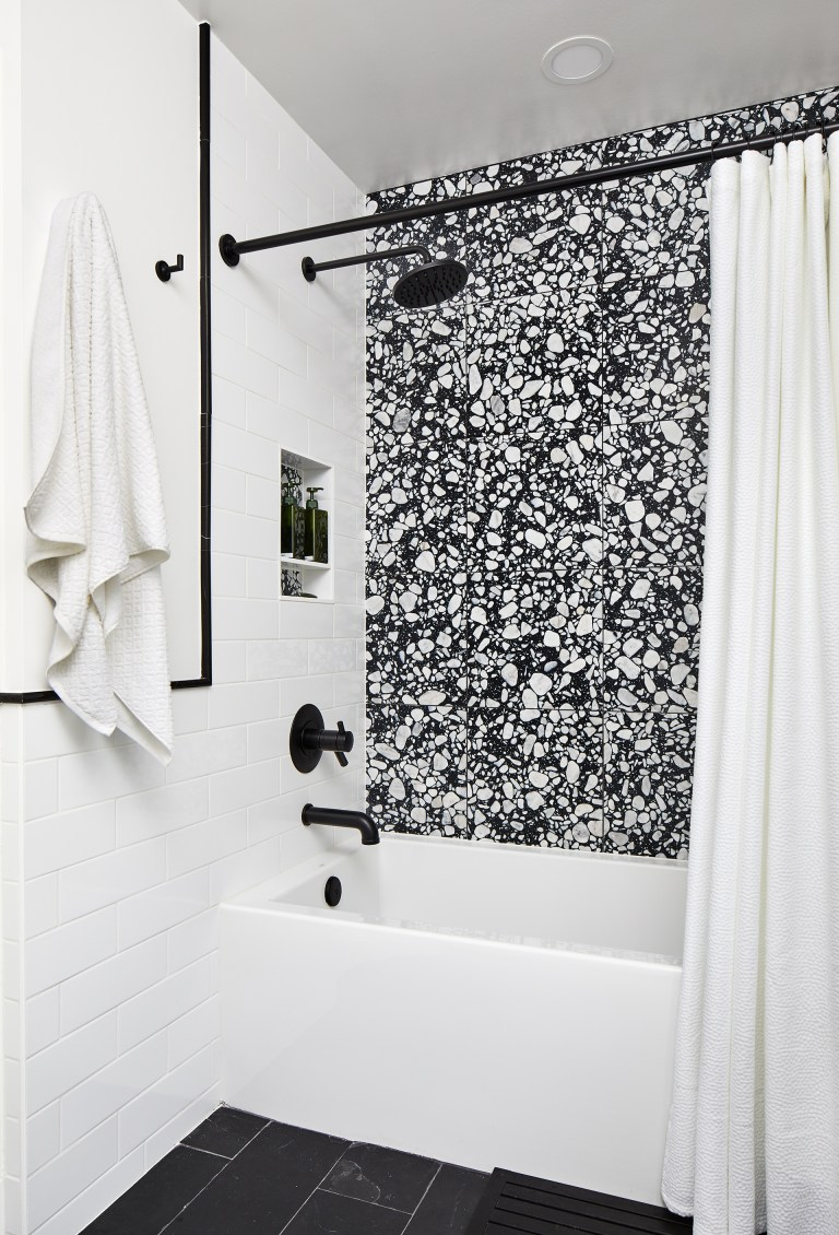 remodel bathroom in dc with matte black curtain rod with large white tub and black faucets