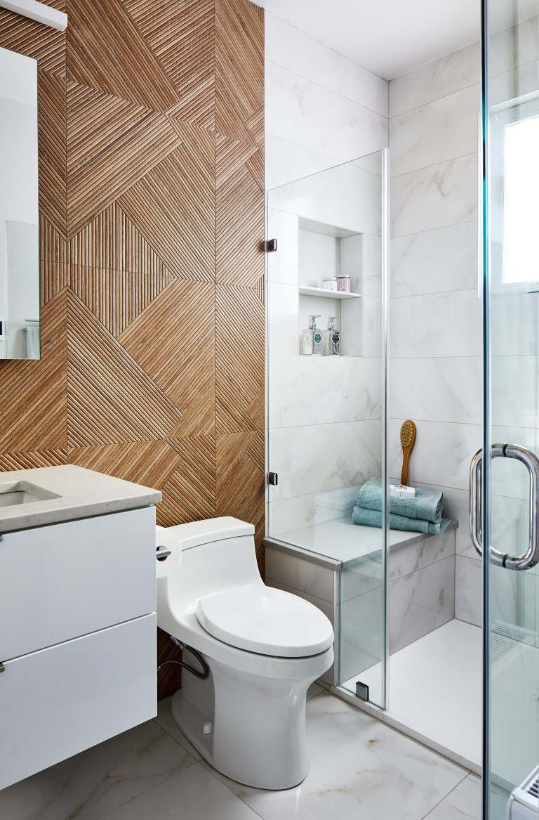 Washington dc remodeling contractor bathroom with floating shelf over the vanity and frameless glass shower