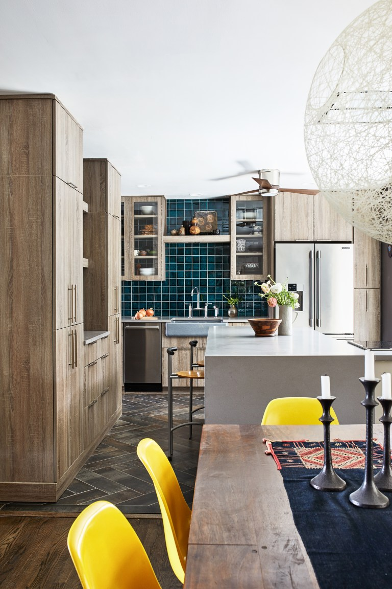 eclectic kitchen renovation with natural wood cabinetry and teal tiling
