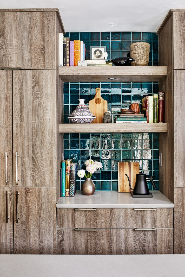 display and storage area with natural wood floor to ceiling cabinetry and open shelving
