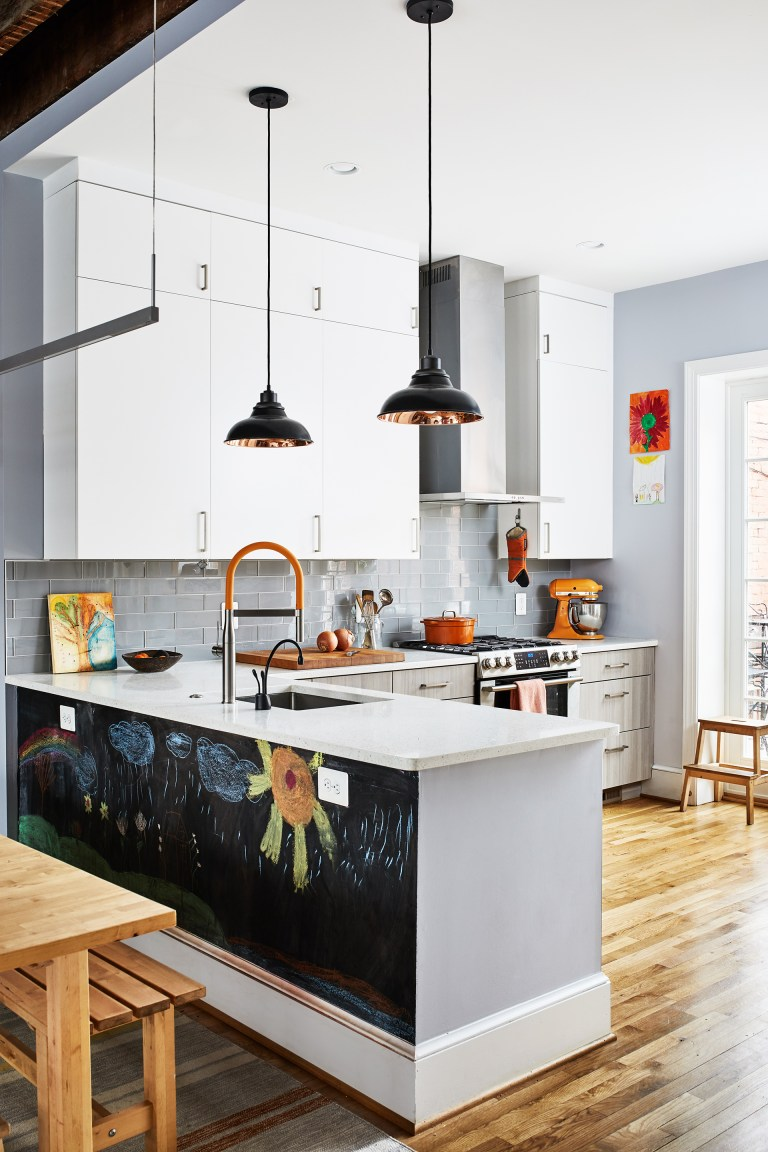 gray and white DC kitchen with wood floors glass doors and chalkboard on back of peninsula