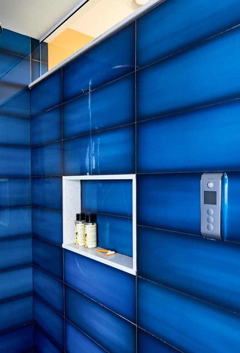 blue tile in shower with storage niche