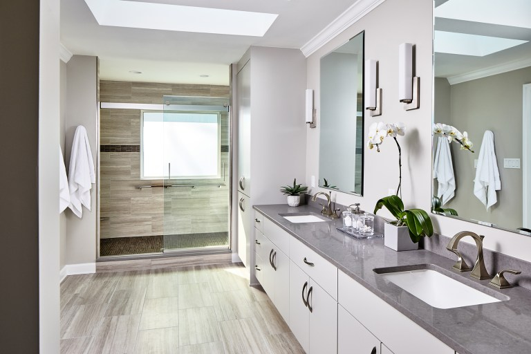 Maryland remodeler bathroom with vanity, two sinks, two mirrors and wall fixtures light