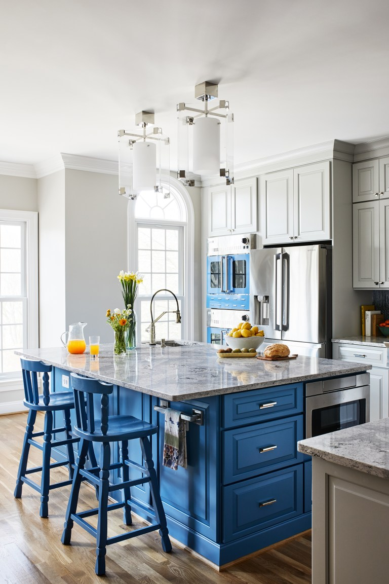 kitchen with island seating and blue cabinetry pendant lighting