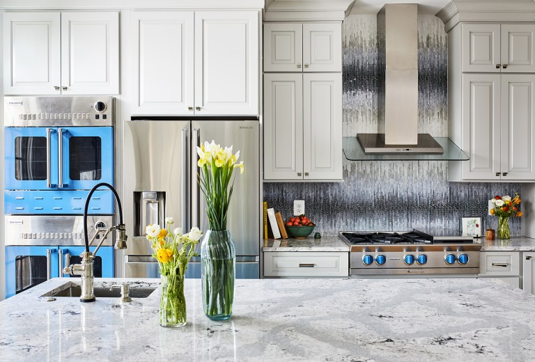 white kitchen with blue accents stainless steel gas range with blue knobs blue wall oven
