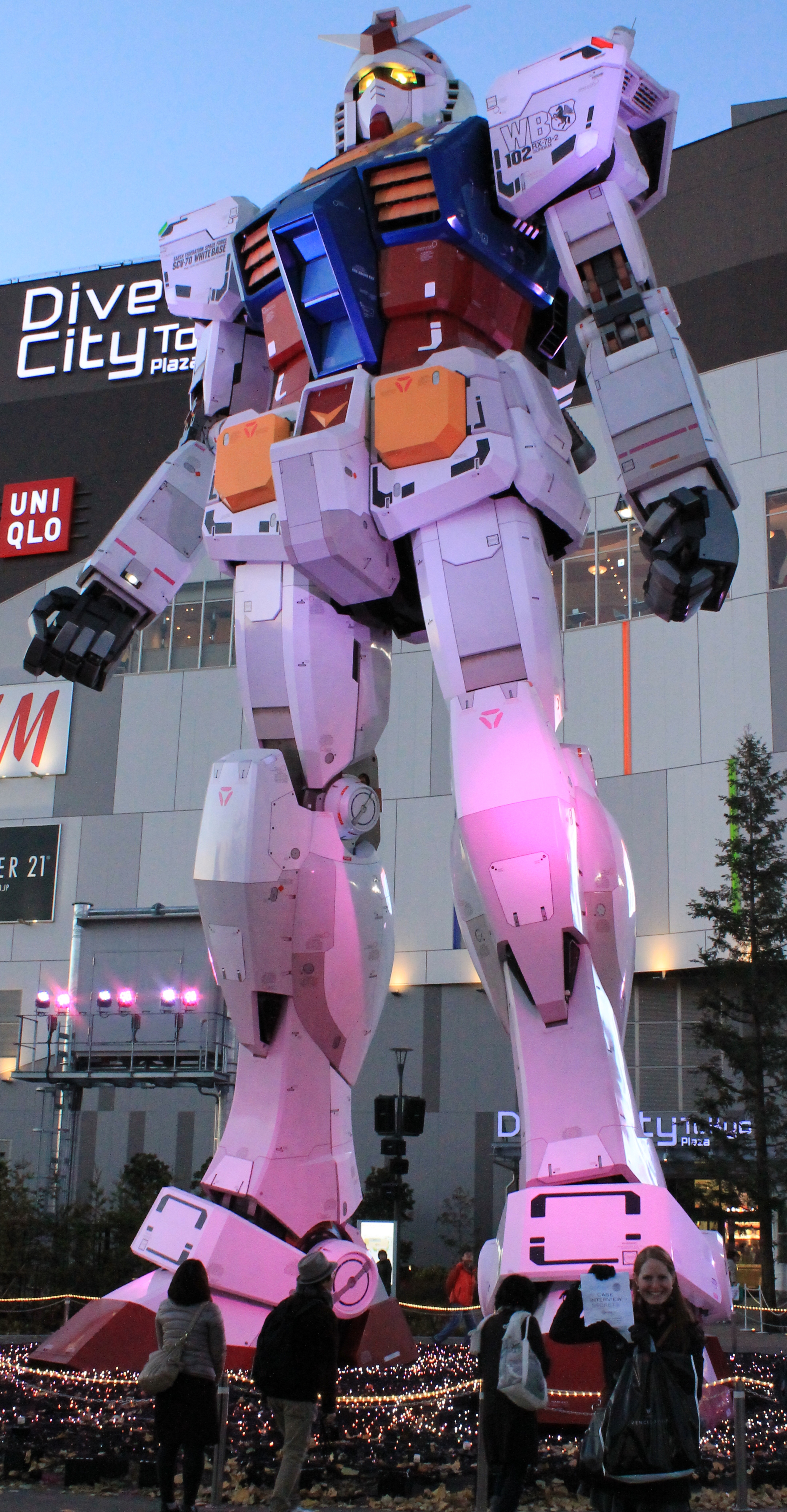 in front of a life size gundam super popular japanese anime