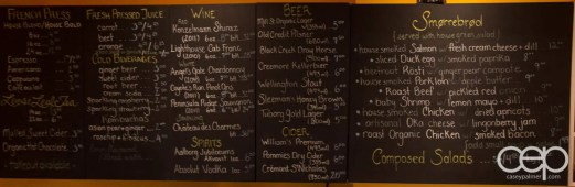 The Karelia Kitchen Smørrebrød Menu outlining the French Press, Loose Leaf Tea, Fresh Pressed Juice, Cold Beverages, Wine, Spirits, Beer, Cider, Smørrebrød and Composed Salads