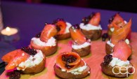 Smoked salmon with sweet berries on potatoes at the Women's Brain Health Initiative launch party.