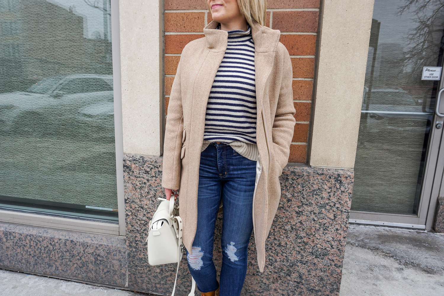 striped sweater and camel coat