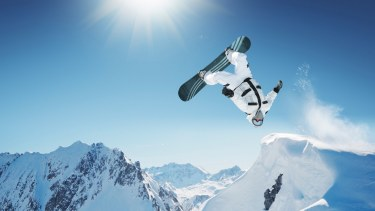 A snowboarder demonstrating a trick in this extreme sport