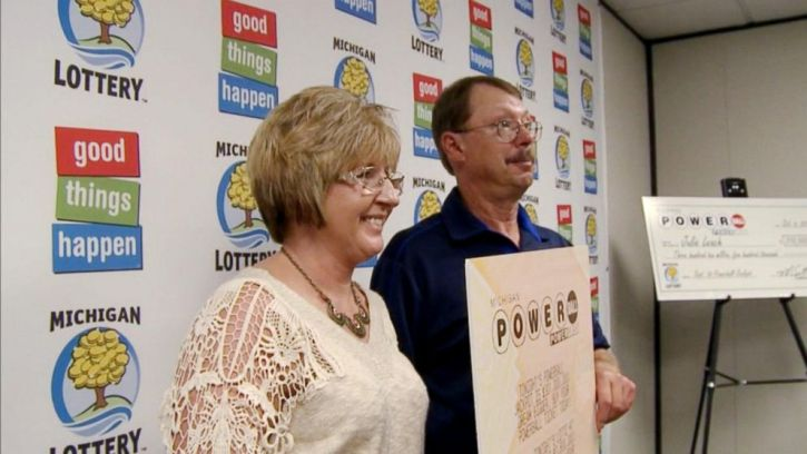 Lottery winners posing with their winning ticket/numbers