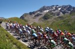 cyclists race past mountains in france