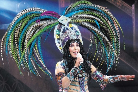cher performing in vegas with big head dress