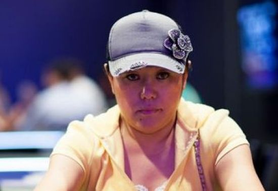 Kelly pictured in a grey cap at a live poker event