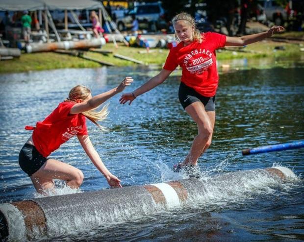 people running on log in water