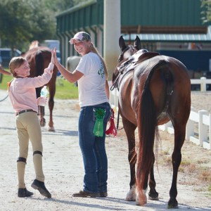 trainer/instructor Gina Pengue with horse riding student