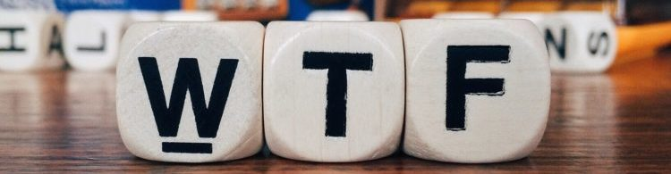 "Close up of three wooden cubes with the letters ""WTF"""