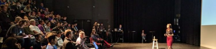Side view of Cassandra speaking in front of the audience at TestBash Philly 2017