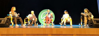 Four speakers on stage at the J on the Beach 2018 Round Table Session