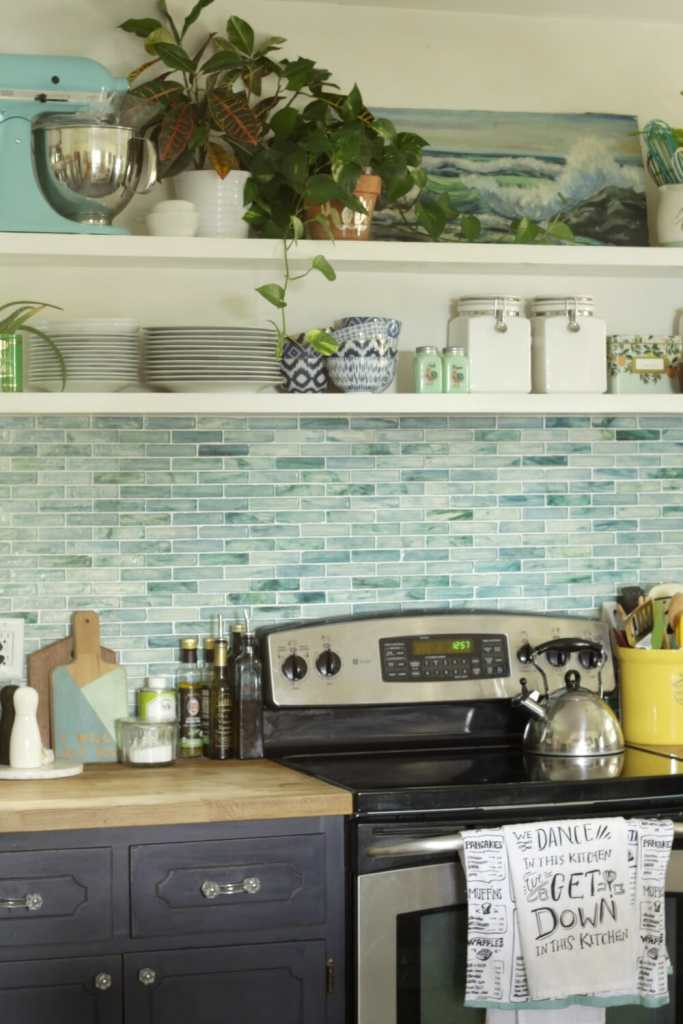 kitchen-with-open-shelving-blues-greens-plants