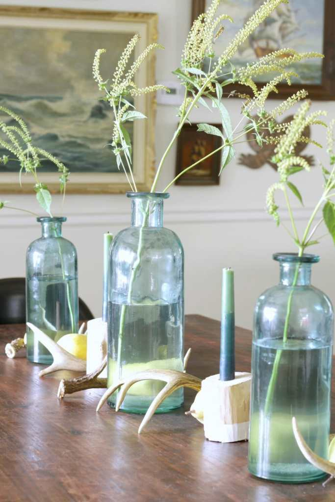simple-fall-table-centerpiece-antlers-pears-weeds-bottles