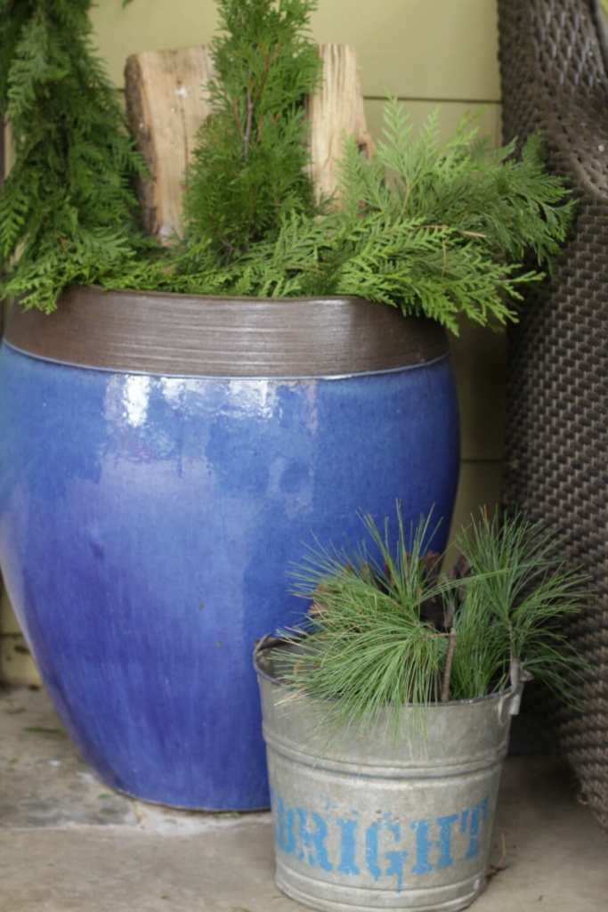 Blue Urn with Greenery and Firewood