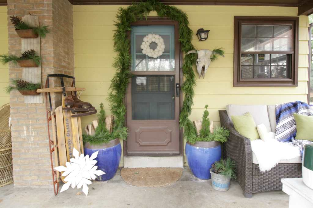 Eclectic Blue & Green Christmas Porch with Greenery and Vintage Touches