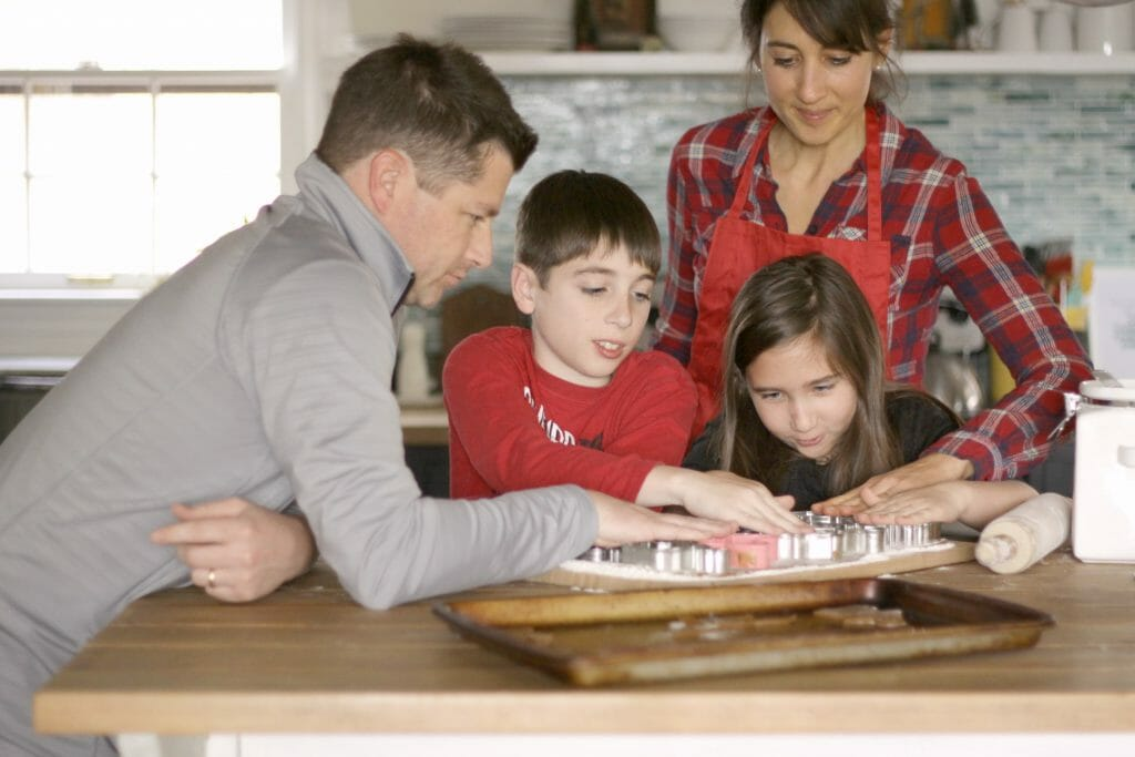 Family Cutting Cookies Together