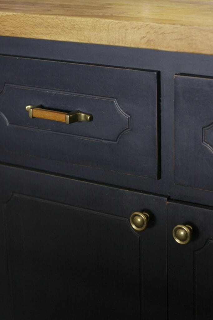 Wood and Brass Knobs and Pulls with Navy Cabinets