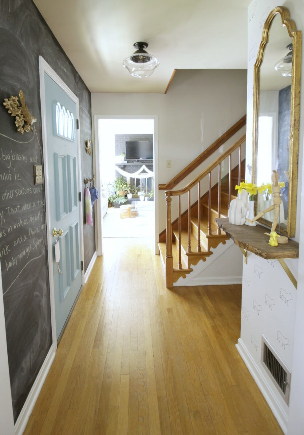 tiny cape cod foyer with new lighting