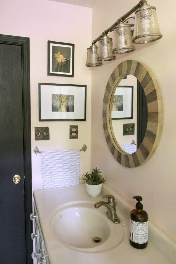 Eclectic Pink Bathroom with Industrial Light Fixture