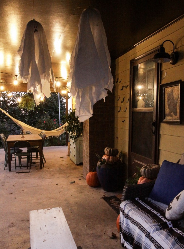 Ghosts flying on halloween porch