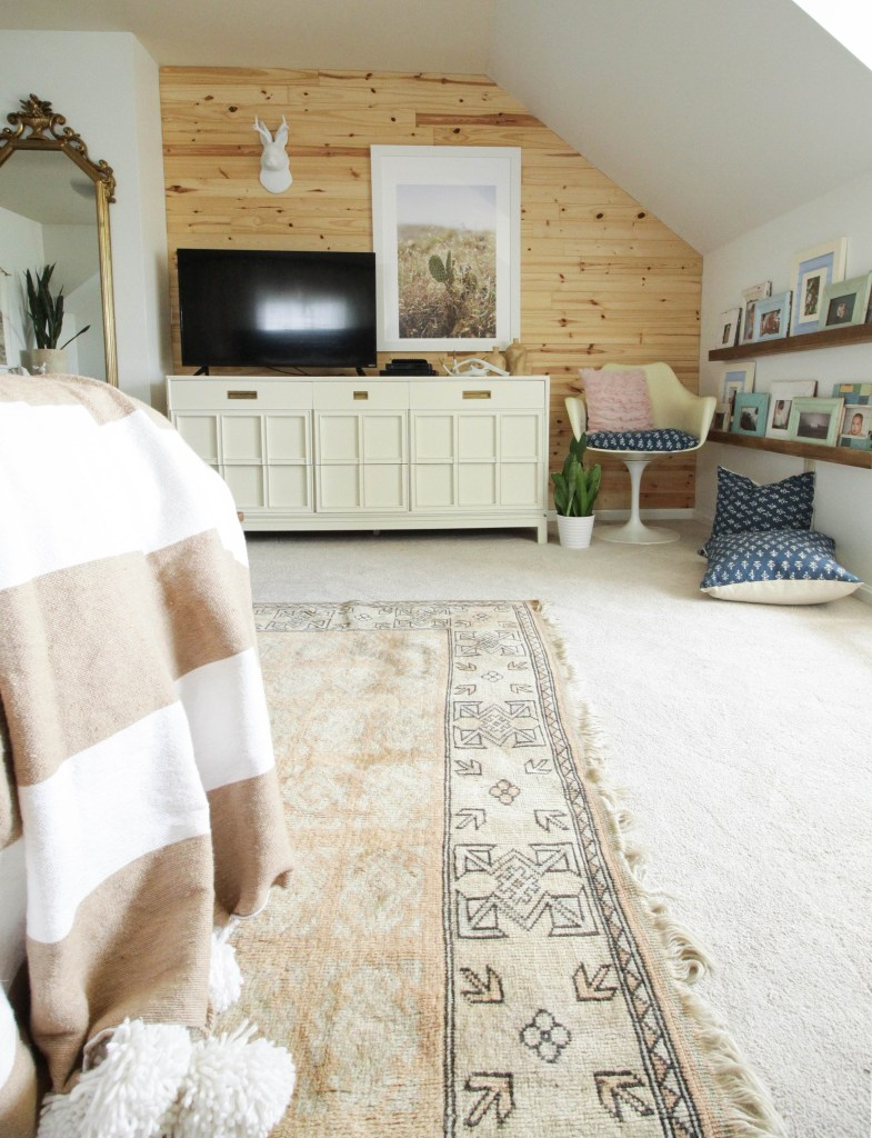 Modern Bohemian Bedroom with vintage textiles and planked modern wood wall