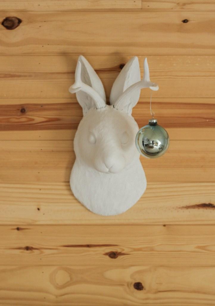 Jackalope with whimsical Christmas ornament