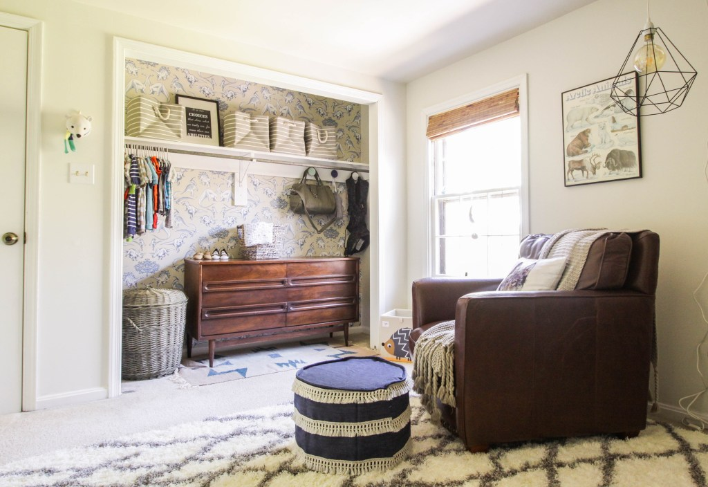 Boys nursery featuring wallpapered closet
