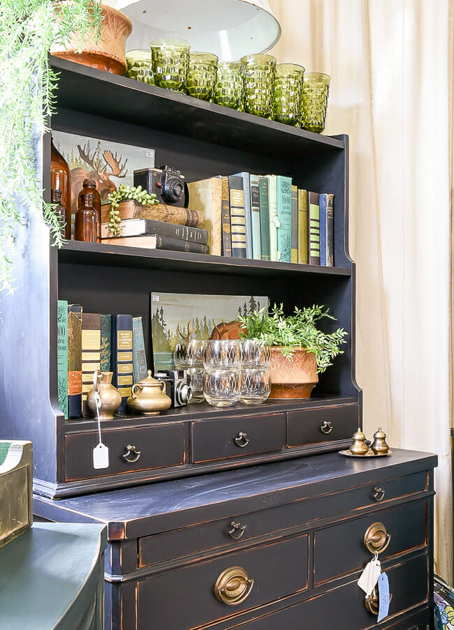 Bookcase styling in blue and green